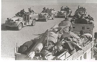 Long Range Desert Group - 'Y' and 'R' Patrol Chevrolets meet in the desert, mid-1942. Note the amount of equipment carried on the nearest 'R' Patrol trucks