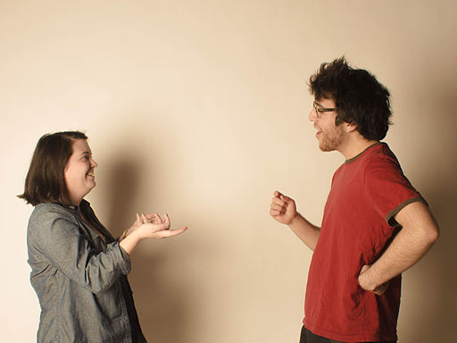 Two young people demonstrating a lively conversation