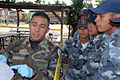 U.S. Air Force Staff Sgt. Edgar Castro, Joint Security Forces, explains crime scene processing paperwork to students from the La Paz Police Academy during a training course at Soto Cano Air Base, Honduras, Oct 071026-F-AV342-004.jpg
