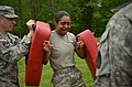 U.S. Army 1st Sgt. Anita Wyatt, center, with Headquarters and Headquarters Company, 105th Military Police Battalion, North Carolina Army National Guard, makes her way through a defense course during oleoresin 130501-Z-AY498-005.jpg