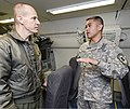 U.S. Army Maj. William Taylor, right, the officer in charge of the combat training squadron for the 138th Military Intelligence Company, explains to Navy Rear Adm. John Haley, the U.S. Strategic Command director 140307-Z-XI378-007.jpg