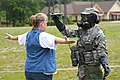 U.S. Army Pfc. Osheannia Pauling, right, with the 108th Chemical Company, South Carolina Army National Guard, scans a woman for radiation during Ardent Sentry 13 at Hampton Regional Medical Center in Varnville 130518-Z-WS267-012.jpg