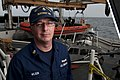 U.S. Coast Guard Maritime Enforcement Specialist 1st Class Brian Wilson, a boarding team officer and a law enforcement instructor, poses for a photo aboard the national security cutter USCGC Bertholf (WMSL 750) 120914-G-VS714-187.jpg