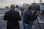 U.S. Navy Capt. Greg Fenton, the commanding officer of the aircraft carrier USS George Washington (CVN 73), center, answers questions from news anchors from Today Show Australia during a live news cast on 130730-N-TE278-073.jpg