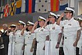 U.S. Navy Rear Adm. Mark L. Tidd, third from right, chief of Navy chaplains, salutes a color guard unit with other Navy officers during the national anthem at the weekly pass in review graduation in the USS 120803-N-IK959-510.jpg