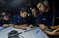 U.S. Sailors in the combat information center aboard the guided missile cruiser USS Monterey (CG 61) use a maneuvering board to plot the ship's course in the Persian Gulf July 30, 2013 130730-N-QL471-153.jpg