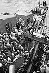 USS Nicholas (DD-449) transfers surviors from the sunken USS Helena (CL-50), 7 July 1943.jpg