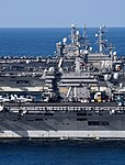 USS Nimitz (CVN-68), USS Theodore Roosevelt (CVN-71) and USS Ronald Reagan (CVN-76) underway in the Western Pacific on 12 November 2017 (171112-N-XC372-2370).jpg