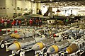 US Navy 030321-N-9403F-040 Skids of 2,000-pound precision guided ordnance wait in the Ship's Hangar Bay to be transferred to the flight deck aboard USS Abraham Lincoln (CVN 72).jpg
