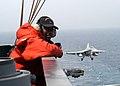 US Navy 030430-N-6410T-510 Seaman Marlin Baggett stands watch as an F-A-18C Hornet from the.jpg