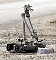US Navy 041103-N-4614W-033 A U.S. Army explosive ordnance disposal (EOD) robot, i-Robot, pulls the wire of an alleged improvised explosive device (IED), found by the Iraqi Police (crop).jpg