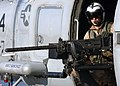 US Navy 041231-N-5345W-054 Aviation Warfare Systems Operator 3rd Class Ryan Branco mans a .50 caliber machine gun.jpg