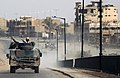 US Navy 050129-N-1810F-276 U.S. Navy Seabees assigned to Naval Mobile Construction Battalion Twenty Three (NMCB 23) patrol the streets of Fallujah, on the day prior to Iraq's historic democratic elections.jpg