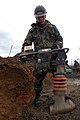 US Navy 050215-N-2385R-042 Steel Worker 3rd Class Mat Martin, assigned to Naval Mobile Construction Battalion Four Zero (NMCB-40), Detachment Sasebo, operates a mechanized hand tamper to compact the gravel over a foundation.jpg