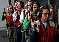US Navy 050311-N-5345W-066 Photographer's Mate 3rd Class Lilliana La Vende, right, leads a group of Sailors back into the hangar bay after completing the 9mm pistol portion of a live-fire small arms qualification aboard USS Har.jpg