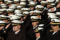 US Navy 051203-N-0295M-011 U.S. Naval Academy Midshipmen salute as the National Anthem is sung during opening ceremonies for the 106th playing of the Army vs. Navy Football game.jpg