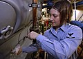US Navy 060606-N-6293B-052 Engineman 3rd Class Samantha Stroudt, performs pre-operational checks on an emergency diesel generator to ensure it is properly lubricated aboard the nuclear-powered aircraft carrier USS Enterprise (C.jpg