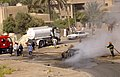 US Navy 060808-N-7590D-055 Iraqi firefighters extinguish a vehicle fire in Baghdad after it was hit by a mortar that was fired by insurgents.jpg