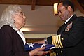 US Navy 070421-N-0924R-066 Deputy Commander, U.S. Fleet Forces Command, Vice Adm. Melvin G. Williams hands the national ensign to Capt. Thomas David Parham's widow during a memorial service in his honor.jpg