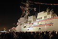 US Navy 070609-N-9909C-015 Sailors man the rails of the newest Arleigh Burke-class guided-missile destroyer, USS Kidd (DDG 100), during an evening commissioning ceremony.jpg