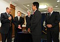 US Navy 080911-N-5549O-028 ecretary of the Navy (SECNAV) the Honorable Dr. Donald C. Winter present Arlington County board chairman Walter Tejada with steel fragments taken from the Pentagon.jpg
