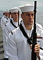 US Navy 080921-N-1745W-109 Members of the aircraft carrier USS Abraham Lincoln (CVN 72) honor guard stand at parade rest during a burial at sea for nine former service members.jpg
