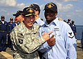 US Navy 081127-N-7571S-020 U.S. Army Gen. David H. Patraeus awards a Sailor with his Surface Warfare pin.jpg