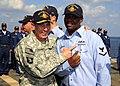 US Navy 081127-N-7571S-020 U.S. Army Gen. David H. Patraeus awards a Sailor with his Surface Warfare pin.jpg