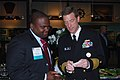 US Navy 090330-N-9268E-003 Vice Adm. Dirk J. Debbink, Chief of Navy Reserve and commander, Navy Reserve Force, speaks with Sammie Dow, a student attending a reception at the Historically Black College and University conference.jpg