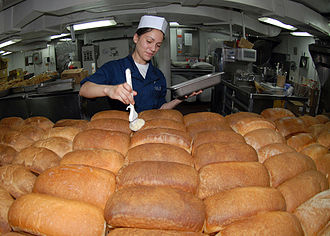 Culinary specialist (United States Navy) - Image: US Navy 090716 N 6720T 017 Culinary Specialist Seaman Samantha Garza butters loaves of fresh baked bread in the bakeshop aboard the aircraft carrier USS George Washington (CVN 73)
