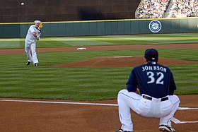 US Navy 090724-N-2143T-002 Hull Technician 1st Class John Parkin, from Des Moines, Iowa, throws the opening pitch to Seattle Mariners catcher Rob Johnson during Seattle Mariners Military Appreciation Night.jpg