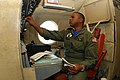 US Navy 090910-N-6651N-007 Chief Warrant Officer Leighton DaCosta performs pre-flight set-up on a P-3 Orion during the platform-specific phase of his Chief Warrant Officer Flight Training program at Patrol Squadron (VP) 30.jpg