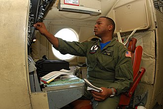 Warrant officer (United States) - CWO2 DaCosta performs pre-flight setup on a P-3 during the platform phase of the CWO Flight Training Program (2009)