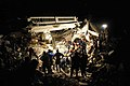 US Navy 100117-N-6070S-007 Members of the Los Angeles County Fire Department Search and Rescue Team clear debris at a collapsed building in downtown Port-au-Prince.jpg