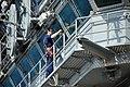 US Navy 100125-N-8421M-024 Quartermaster 2nd Class Cameron Fletcher cleans the flag bridge windows aboard the aircraft carrier USS Nimitz (CVN 68).jpg
