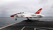 US Navy 100205-N-9928E-178 apt. Joseph W. Kuzmick, from Bremerton, Wash., commanding officer of the Nimitz-class aircraft carrier USS John C. Stennis (CVN 74), launches from the ship in a T-45C Goshawk.jpg