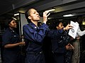 US Navy 100627-N-6003P-011 Culinary Specialist 3rd Class Rebeca Davila leads the gospel choir during Sunday worship service aboard the aircraft carrier USS Harry S. Truman (CVN 75).jpg