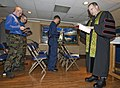 US Navy 100711-N-6720T-010 Cmdr. Brian Haley, the command chaplain aboard the aircraft carrier USS George Washington (CVN 73), reads verses from the Bible during morning services.jpg