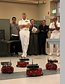 US Navy 100913-N-3038C-014 Rear Adm. William D. French watches a mobile robotics demonstration by mechanical engineering students at Utah State Uni.jpg