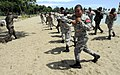 US Navy 100913-N-9643W-057 Sgt. Georman Elder conducts elbow strikes with members of the Dominican Republic military during a Marine Corps martial.jpg