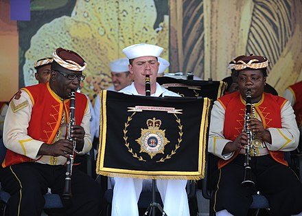 The Jamaica Regiment band performed with members of the United States naval band. US Navy 110421-N-NY820-071 Musician 3rd Class Fred Vaughan, assigned to the U.S. Fleet Forces Band, and members of the Jamaican Defense Force Band.jpg