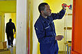 US Navy 110908-N-IZ292-359 perations Specialist Seaman Dillian Cannady paints a classroom wall in the Specialized School in PORT LOUIS, Mauritius,.jpg