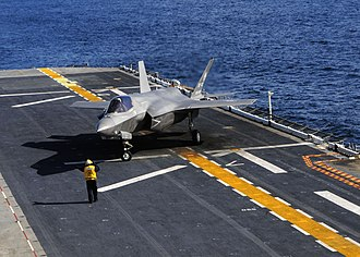 USS Wasp (LHD-1) - A USMC F-35B conducting the first vertical landing on a flight deck aboard Wasp on 3 October 2011