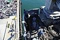 US Navy 111114-N-UE944-113 Deck department sailors pull lines aboard the amphibious assault ship USS Makin Island (LHD 8) as the ship departs San D.jpg
