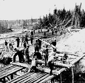 History of the Northwest Territories - Work crew building gravel loading platforms, Alaska Highway, 1943.