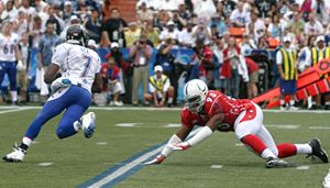Quarterback - Michael Vick, a member of the NFC team at the NFL's 2006 Pro Bowl, uses his mobility to elude Dwight Freeney.