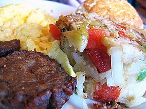 English: Veggie sausage, scrambled eggs and ho...
