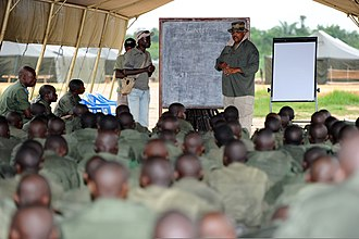 Timeline of Kisangani - Image: Wahid Ali, company trainer for Congolese soldiers assigned to the Congolese Light Infantry Battalion, reviews basic military principles of entering and clearing a building at Camp Base in Kisangani, Congo, May 100505 F FW561 055