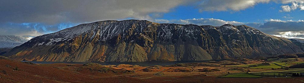 Panorama of the Wasdale screes descending into Wastwater, the deepest lake in England.