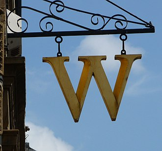 Waterstones - Early versions of shop signage were gold in colour